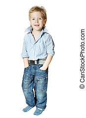 Smiling little boy standing and looking at camera