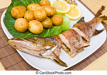 Fresh baked pike with potatoes