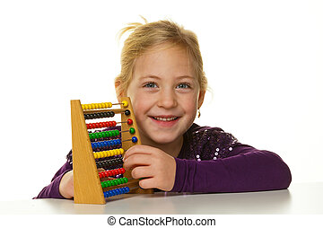 school child is expecting an abacus - a very young girl is...