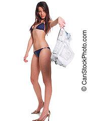 Bikini - A young sexy adult girl in bikini holding shorts