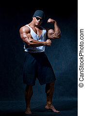 strong athletic man in dark glasses