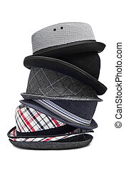 hats - stack of different and trendy hats on a white...