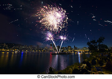People Watching Fireworks by the River in Portland Oregon -...