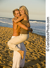 Young attractive couple embrace at beach