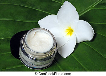 Eye cream and frangipani flower - Eye cream on a natural...