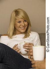 Beautiful woman drinking coffee on the lounge