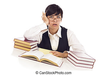 Bored Mixed Race Female Student at Desk with Books