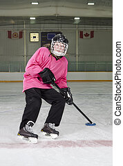 Ringette Skater in Action at Rink - A Tween Ringette Player...