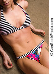 On the Beach - A beautiful Torso soaks up the Sun on the...