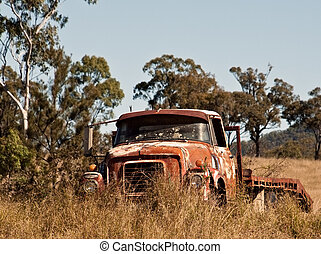 Australian outback rusty old farm truck in paddock