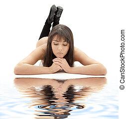 bored girl on white sand - bored brunette in black boots...