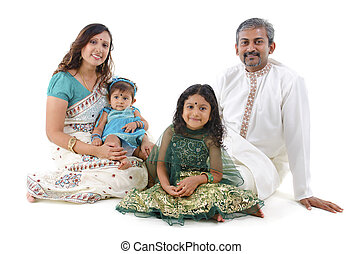 Traditional Indian family - Happy Indian family sitting on...