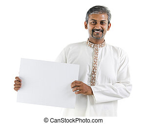 White board - Mature Asian Indian businessman holding a...