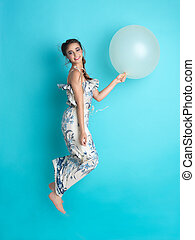 happy young woman jumping with balloon - beautiful, happy,...