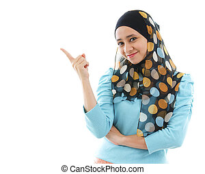 Product here - Cute young Muslim woman pointing on empty...