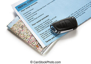 Road map and car key on white