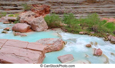 Cascading stream at Grand Canyon - A cascading stream of...