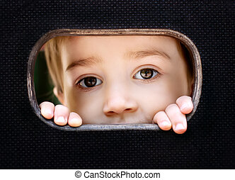 Kid spying through the hole - Curious kid spying through the...