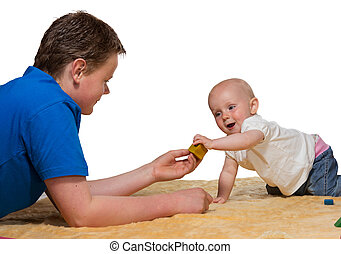 Happy inquisitive baby playing with Dad