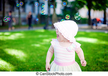 Playing Outdoors With Soup Bubbles