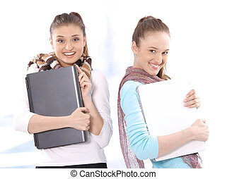 Female students with notebooks - Portrait of smiling...