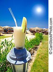 Pina Colada,blue sun and sunny beach - Tasty pina colada on...