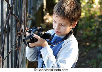Boy takes a photograph