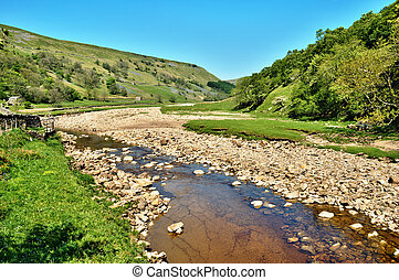 Rocky riverbed of the River Swale - Rocky riverbed and clear...