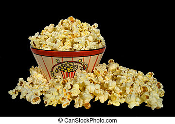 Popcorn on Black - A bowl of popcorn isolated on a black...