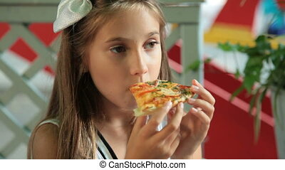 I'm Fed Up - Little girl eating pizza in a fast food...
