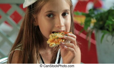 I Have Eaten Enough - Little girl eating pizza in a fast...
