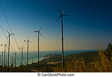 Wind turbines farm on the island - Wind turbines farm with a...