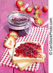 Toast with jam on wood