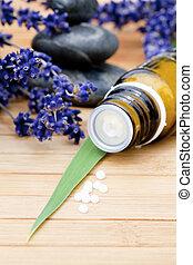 Globuli with lavender on wood