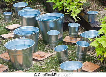 zinc bucket of water - zinc bucket of water standing on the...