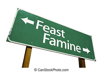 Feast or Famine road sign isolated on a white background....