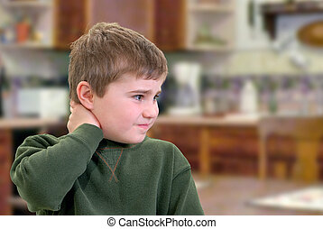 Puzzled Boy - Boy with hand on neck with sad expression