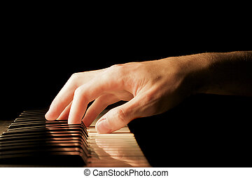 Piano Hand - A caucasian male\\\'s hand playing a keyboard