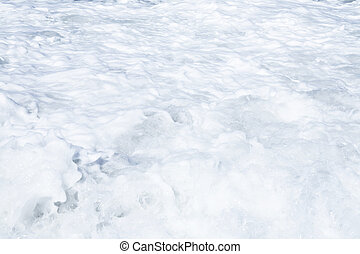 Foamy waves of ocean as a natural background