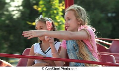 Amusement Park - Two ten-year girls at fun fair