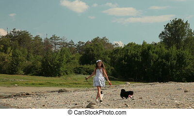 Child with Dogs - A little girl walks her chihuahua outdoor....