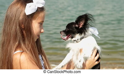 Child with Puppy - Little girl kissing your pet chihuahua...