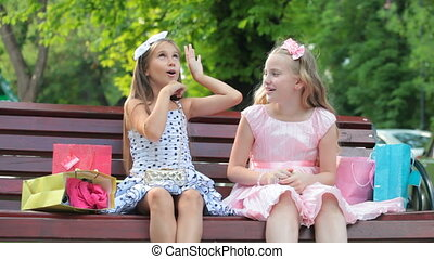 Little Girls with Shopping Bags - Two little girls with...