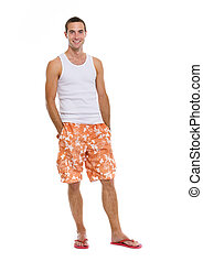 Full length portrait of on vacation smiling young man in...