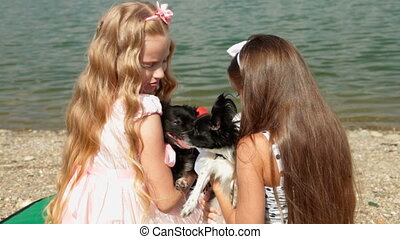 Children With Pets - Two little girls with his chihuahua on...