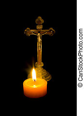 Cross and candle - Cross stand behind a lit candle