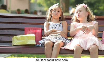 Little Girls with Shopping Bags