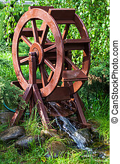 Decorative water wheel in the garden, element of modern...