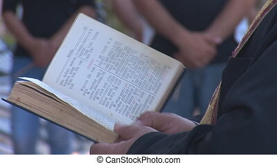 priest 6 - priest reads the Bible