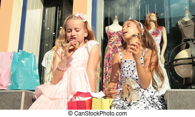 Little Shoppers near Store Window - Little shopping girls...